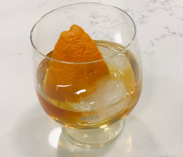 Closeup of an Old Fashion with an orange.