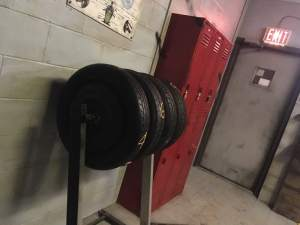 In-game: a rack of tires sitting beside a set of red lockers.