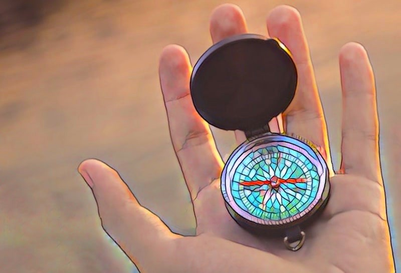 Stylized image of a hand holding a compass.
