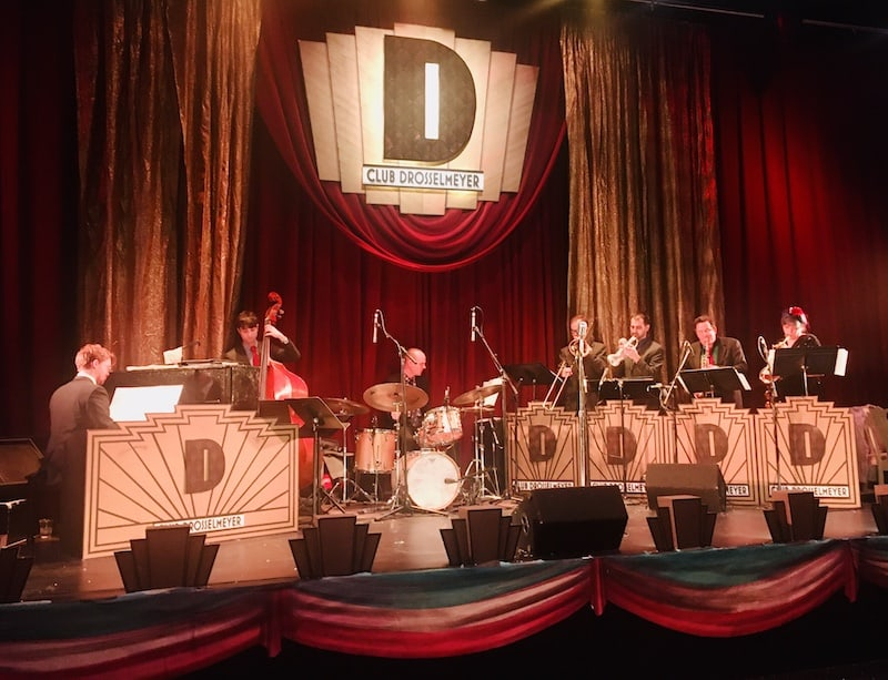 In-game: The band playing on the Drosselmeyer stage.