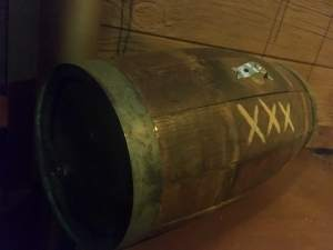 "In-game: closeup of a barrel labeled ""xxx"""