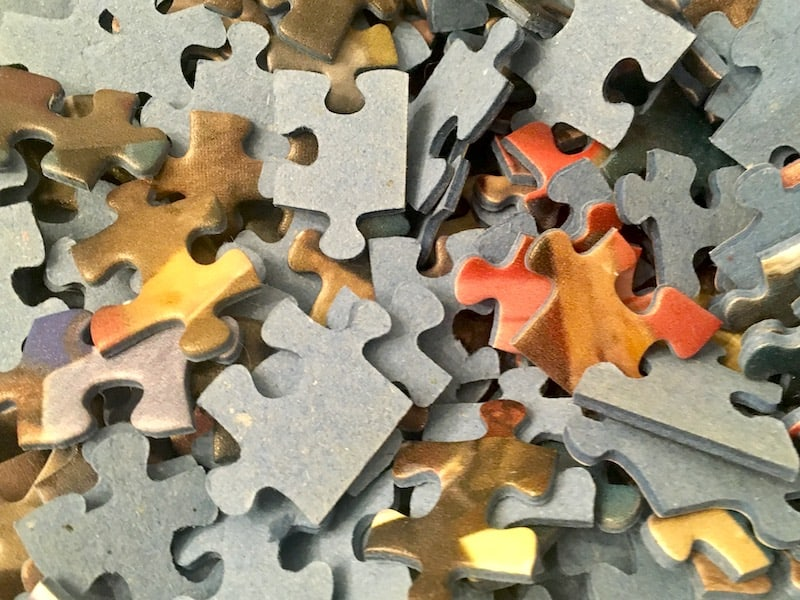 Closeup of Ravensburger puzzle pieces in the box.