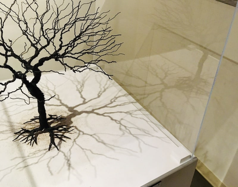 In-game: A sculpture of a tree and root system without leaves.