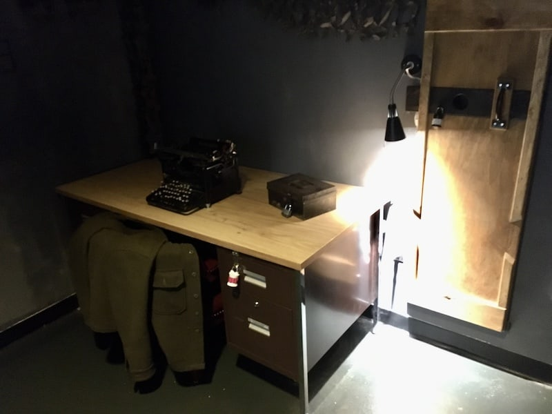 In-game: A desk with a locked box and an old typewriter atop it.