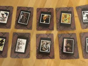 10 stacks of cards with photographs and art on the back.
