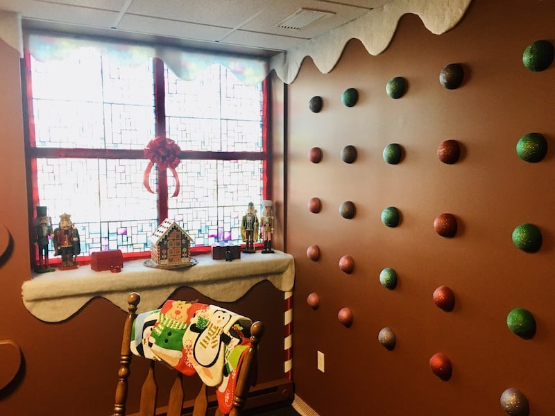 In-game: gingerbread house wall covered in gumdrops.