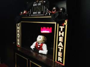 In-game: a boxoffice stand with an owl dressed in fancy clothes sitting within.