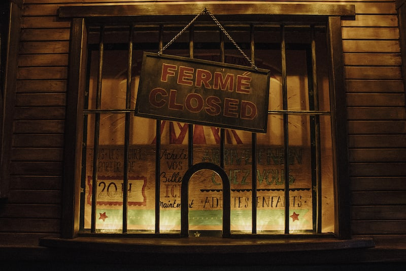 In-game: The ticketbooth for the circus with a closed sign hanging from it.
