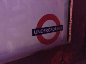 In-game: Close up of a London Underground symbol.