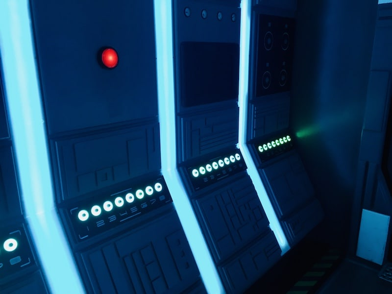 In-game: A big red button glowing on the wall of a futuristic spaceship.