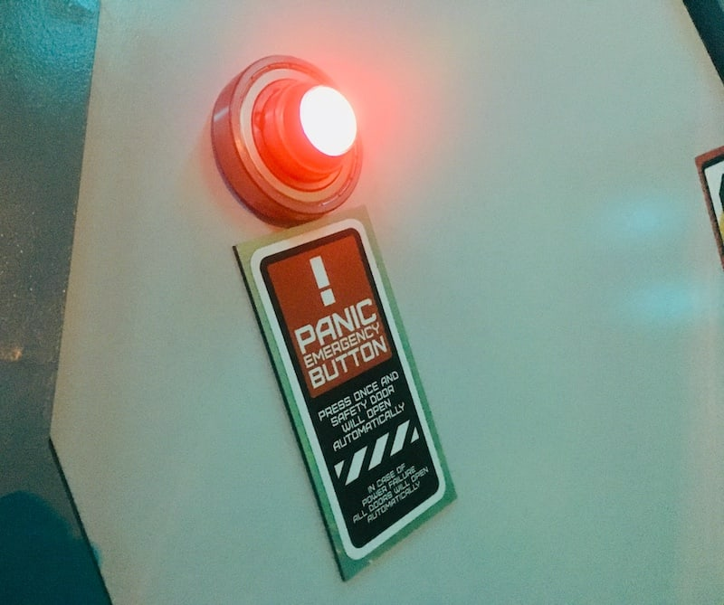 In-game: Closeup of the panic button, emergency exit.