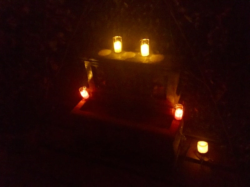 In-game: an alter in a crypt covered in candles.