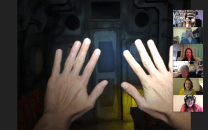 Hands in a first person view of an airplane interior.