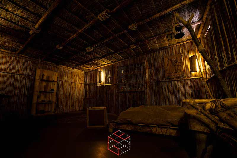 In-game: The interior of a cabin.