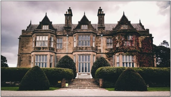 The exterior of a stately manor house.