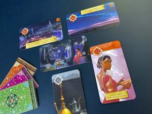 The initial card setup features Scheherazade sitting in a beautiful palace.