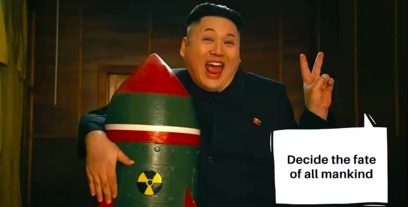 Kim Jung Un cuddling a nuclear bomb and holding up a piece sign.