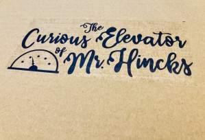 Curious Elevator of Mr Hincks box art, on a card board box.