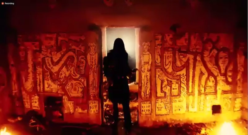 Person entering strange room, surrounded by fire.