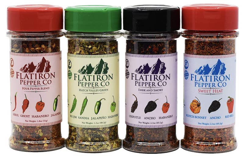 A collection of 4 different bottled pepper blends.