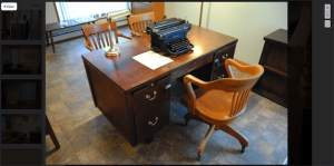 An old desk with a typewriter.