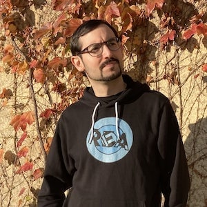 David in the REA hoodie in Autumn