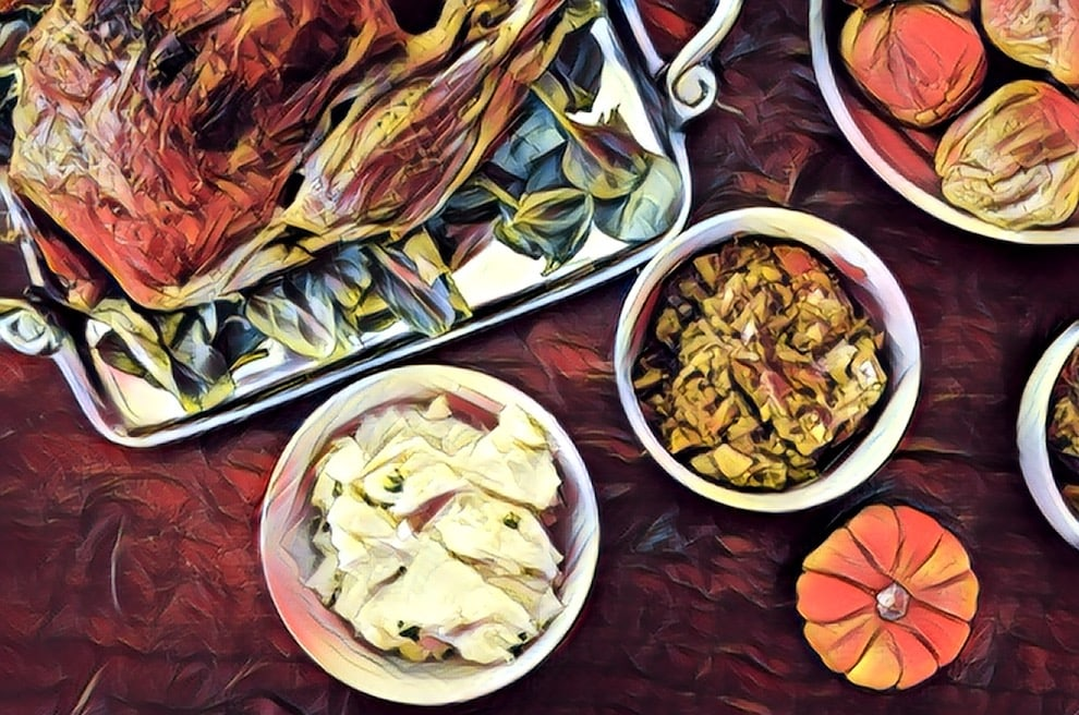 Stylized image of an American Thanksgiving table with turkey, stuffing, potatoes, and bread.