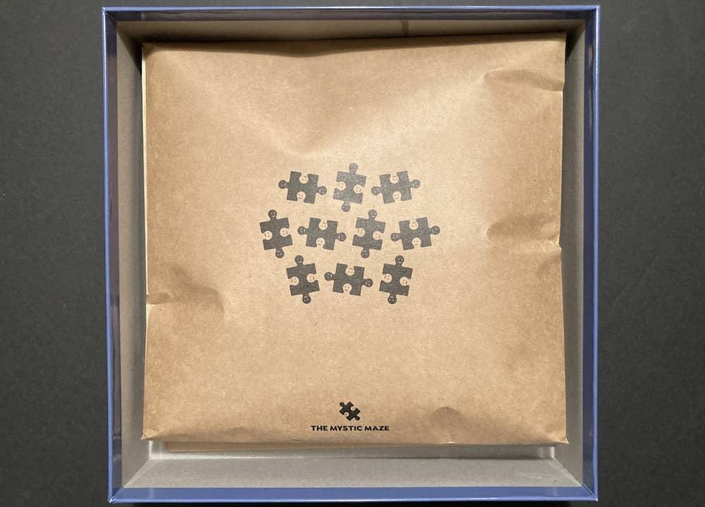 Puzzle pieces in a paper envelope.