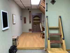 In-game: An attic escape room, there is an unusual set of steps against the wall.