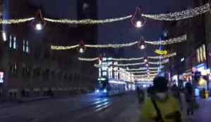 First person view of a street in Amsterdam at night. It is heavily pixelated.