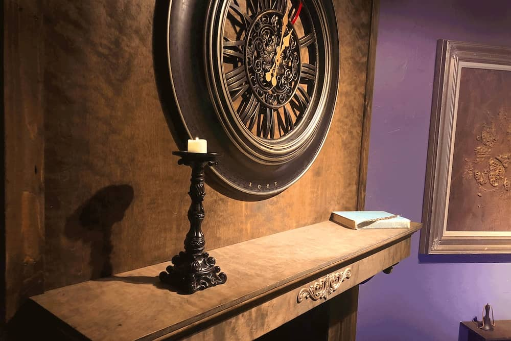 In-game: A candlestick on a shelf, a large steam punk clock is mounted to the wall.