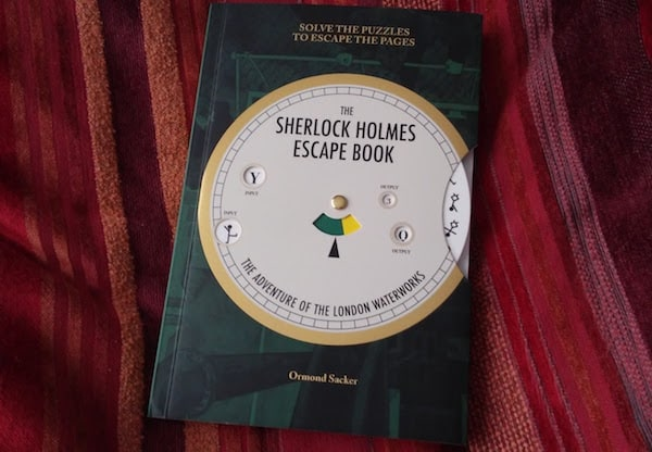 The Sherlock Holmes Escape Book: The Adventure of the London Waterworks cover with code wheel.