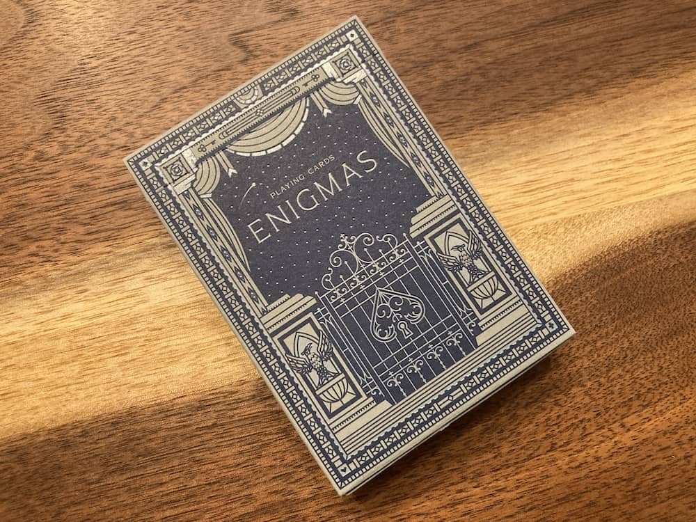 The elegant blue and grey box art for David Kwong's Enigmas deck.