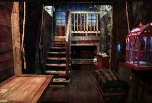 In-game: Interior of a pirate ship. A large chest sits in the middle.