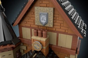 Closeup of the Dollhouse's roof, the family crest and a strange insignia mounted against the brick.