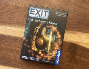 Exit The Game - The Enchanted Forest box art depicts a living tree reaching out for a frog prince.