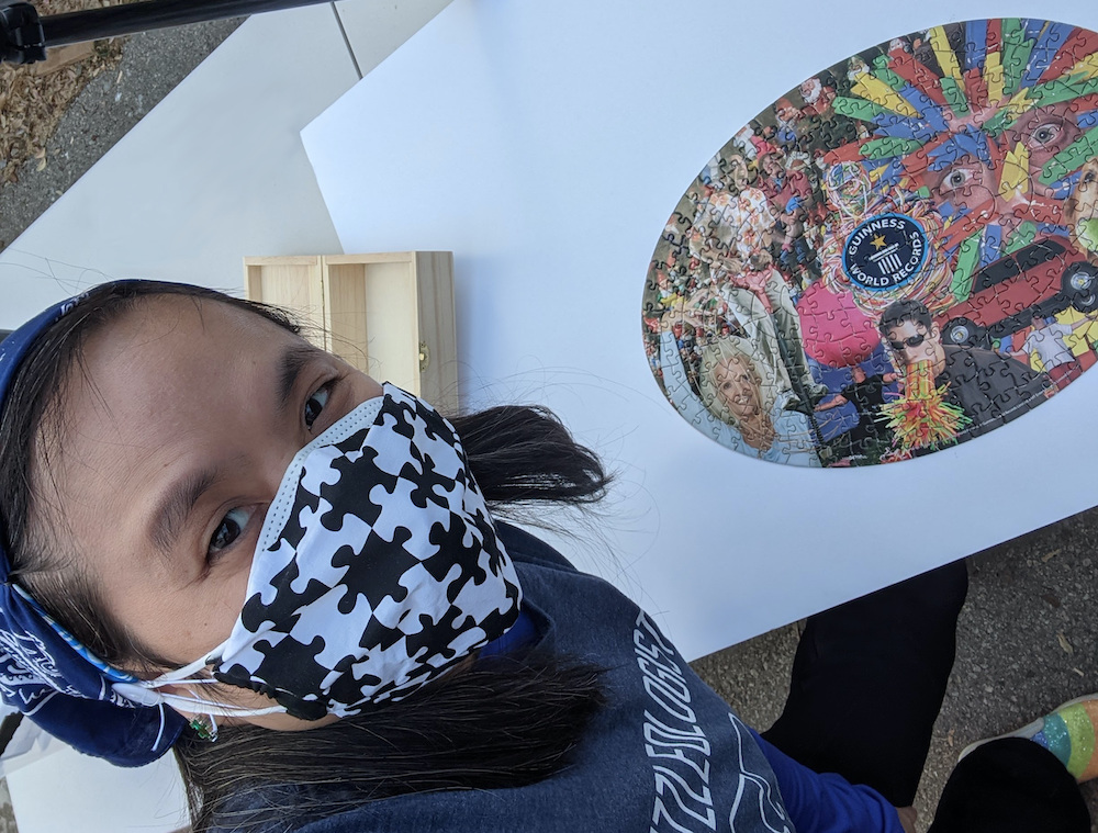 Tammy Selfie with the solved Guinness World Record oval jigsaw puzzle.