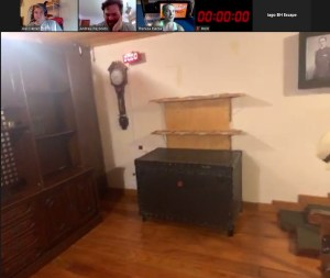 Avatar view of an escape room with antique furniture. A large locked chest is in frame.
