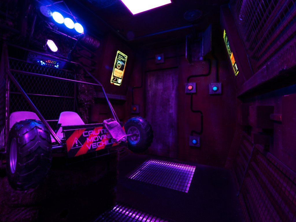 dim room, with what looks like the back end of an off road vehicle.