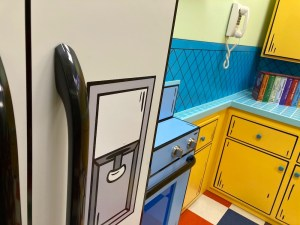 Animated kitchen, a refrigerator, oven, telephone, and cabinets.