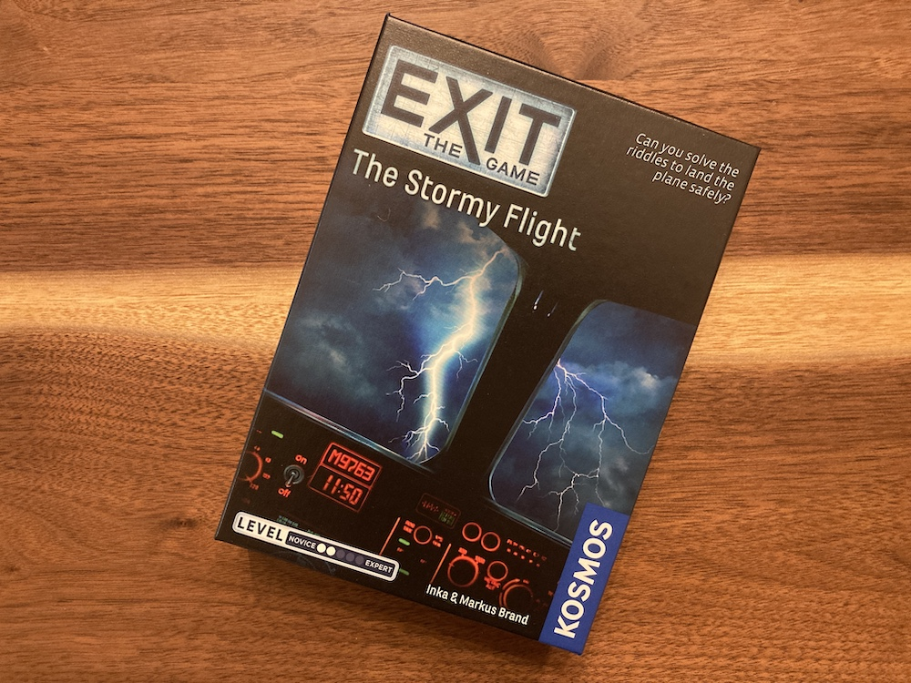 Exit The Game: The Stormy Flight box art depicts a cockpit view of a lightning storm.