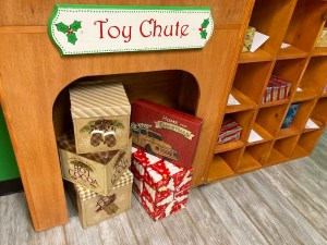 Toy chute filled with toys.
