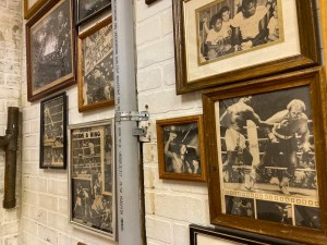 An assortment of framed black & white images of boxing matches.