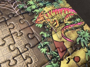 An iguana looking at a puzzle.