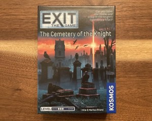 Exit The Game The Cemetary of the Knigh cover art depicts a cemetery at dawn with many ravens