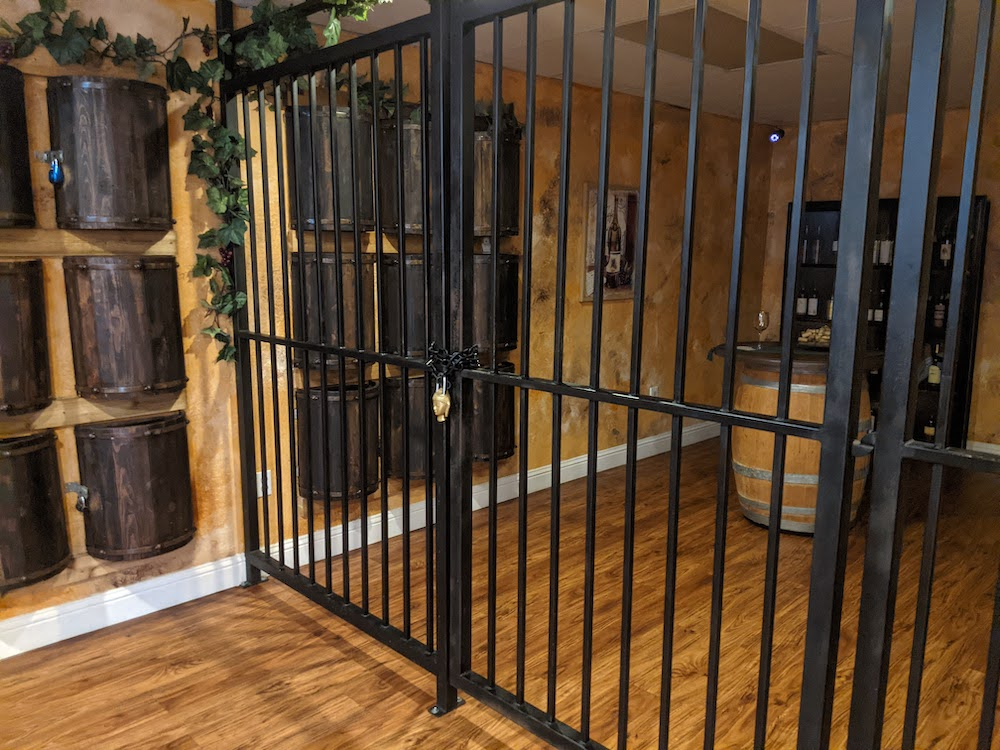 Gated and padlocked divider in a wine cellar.