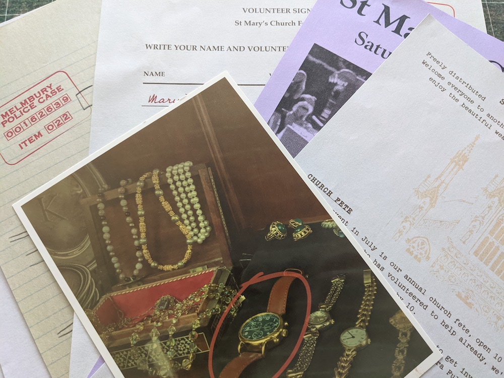 An assortment of crime evidence. In the center of the frame is a photo of a collection of jewelry with a watch circled in red.