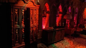 An alter surrounded by gothic arches.
