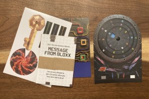 Assorted items from Exit's Gate Between Worlds features an unusual decoder wheel.