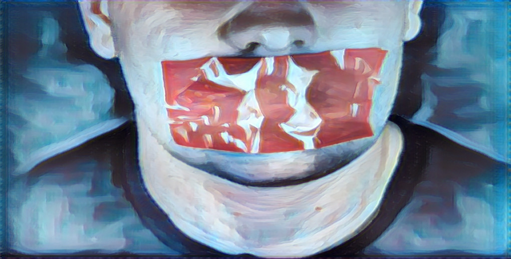 Close-up of a mouth covered in red tape.